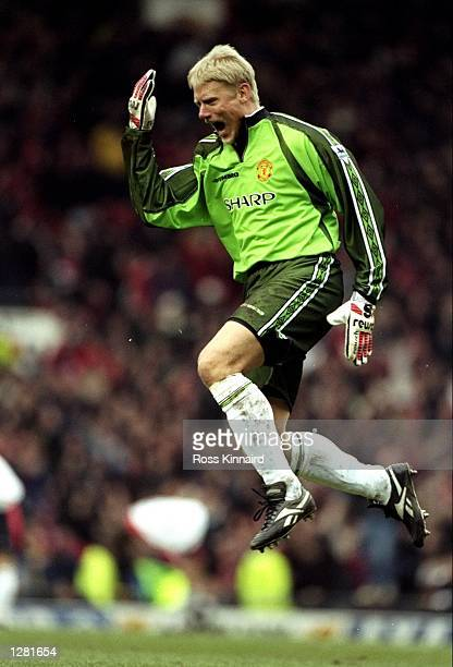 Manchester United keeper Peter Schmeichel celebrates during the FA Cup fourth round clash against Liverpool at Old Trafford in Manchester England...