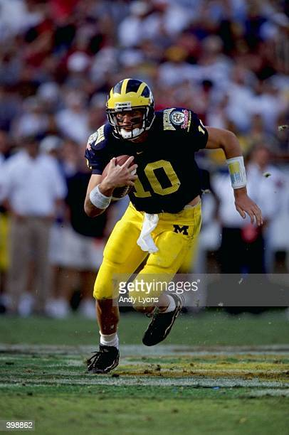 Quarterback Tom Brady of the Michigan Wolverines in action during the Florida Citrus Bowl Game against the Arkansas Razorbacks at the Citrus Bowl in...