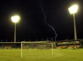 A lightning storm halts play during the Australia Cup women's soccer international between the Australian Matildas and France played at Carrara...