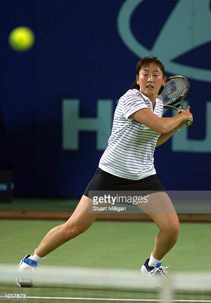 Ai Sugiyama of Japan plays a Backhand during her match against Tamarine Tanasugarn of Thailand during the Hopman Cup Tennis Teams Championships held...