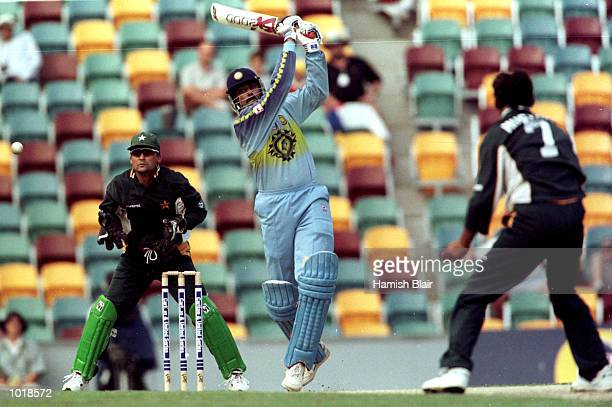 Anil Kumble of India hits out at the bowling of Saqlain Mushtaq of Pakistan as wicketkeeper looks on during the Carlton and United One Day...