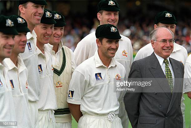 Australia Prime Minister John Howard poses with the Australian cricket team before the first days play of the Third Test Match between Australia and...