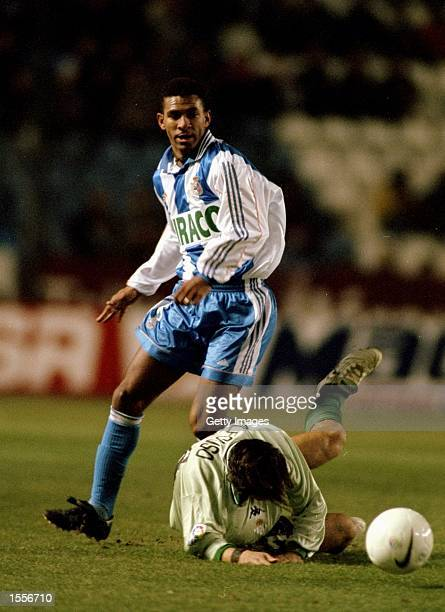 Djalminha of Deportivo La Coruna trips Alfonso of Real Betis during the Spanish Primera Liga match played at the Estadio Municipal de Riazor in La...
