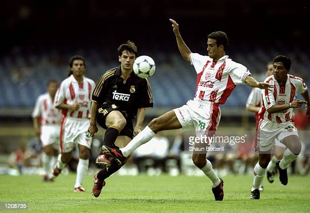 Fernando Morientes of Real Madrid lifts the ball past Markus Lopez of Necaxa during the Third Place Playoff of the World Club Championship played at...
