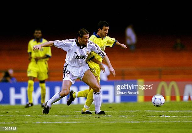 Fernando Redondo of Real Madrid battles with Moussa Saib of AlNassr during the FIFA Club World Championship group A match at the Morumbi Stadium in...