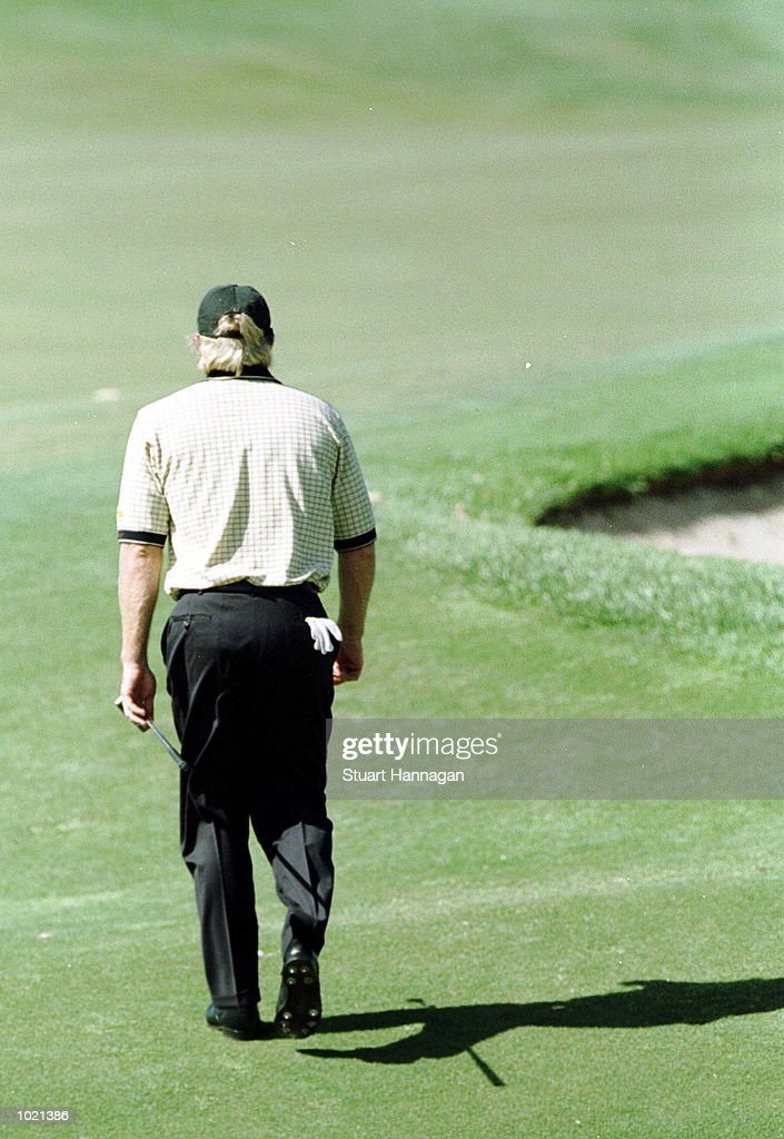 Greg Norman of Australia casts his shadow as he walks the course during the third round of the Heineken Classic 2000 at The Vines Golf Course, Perth, Australia. Mandatory Credit: Stuart Hannagan/ALLSPORT