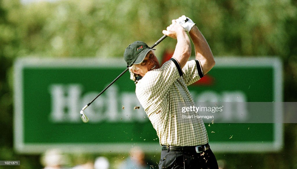 Greg Norman of Australia hits an approach shot to the second green during the third round of the Heineken Classic 2000 at The Vines Golf Course, Perth, Australia. Mandatory Credit: Stuart Hannagan/ALLSPORT