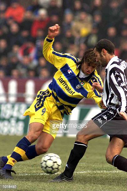 Hernan Crespo of Parma takes the ball past Montero of Juventus during the Serie A match between Parma v Juventus at the Ennio Tardini Stadium Parma...