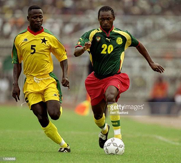 Kalla Kaned Raymond of Ghana and Otto Addo of Cameroon in action in the African Nations Cup game played in Accra Ghana The match ended 11 Mandatory...