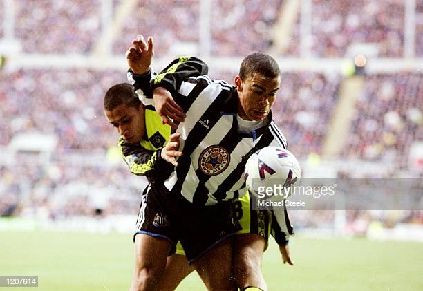 Kieron Dyer of Newcastle is tackled by Curtis Woodhouse of Sheffield United during the FA Cup 4th Round match played at St James's Park in Newcastle...