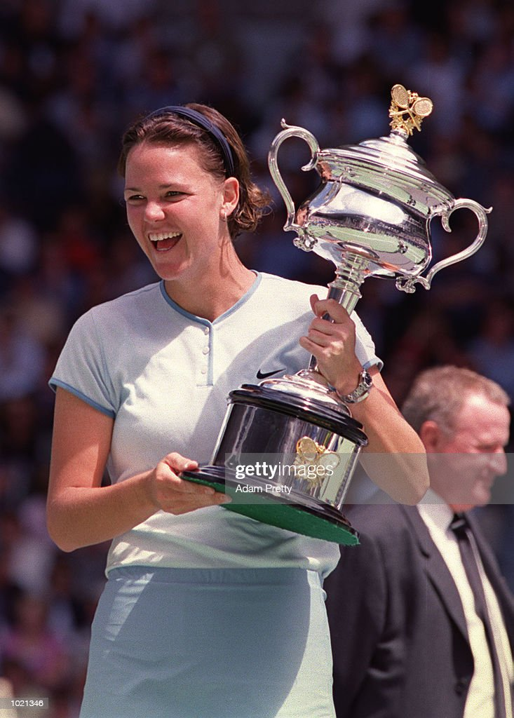 Lindsay Davenport of the USA holds the Australian Open trophy after her win against Martina Hingis of Switzerland in the women's singles final at the Australian Open Tennis Championships at Melbourne Park in Melbourne, Australia. Davenportdefeated Hingis 6-1, 7-5. Mandatory Credit: Adam Pretty/ALLSPORT