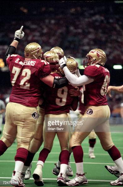 Peter Warrick of the Florida State Seminoles celebrates his touchdown with teammates on the field during the Nokita Sugar Bowl Game against the...