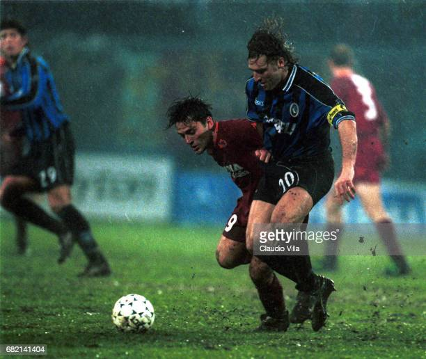 07 jan 2000 SERIE A Vincenzo MONTELLA of ROMA and Massimo CARRERA of ATALANTA compete for the ball during the SERIE A 13rd round game between...