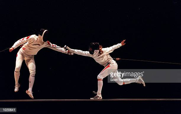 Shao Qi Yang of China is attacked by Ildiko Mincza of Hungary during the womens final at the FIE World Cup Challenge Homebush Australia Mandatory...