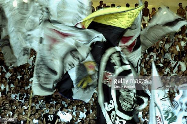 The Vasco de Gama fans watch the action during the World Club Championship match against Manchester United played at the Maracana Stadium in Rio de...