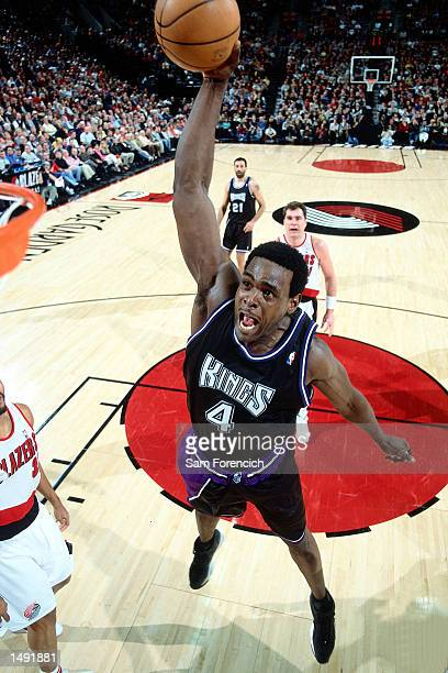 Chris Webber of the Sacramento Kings soars to the basket for a slam dunk against of the Portland Trail Blazers during an NBA Game at The Rose Garden...