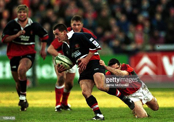 Elton Moncreiff of Gloucester is tackled by the Llanelli defence during the Heineken Cup match between Gloucester v Llanelli at Kingsholm Gloucester...