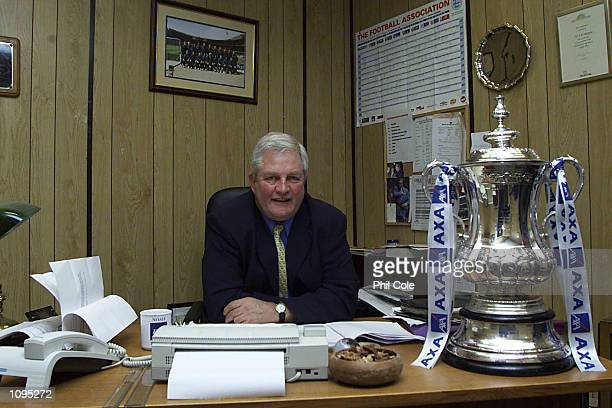 Kingstonian manager Geoff Chappell poses with the FA Cup Trophy in his office during the Kingstonian open day as they prepare for their FA Cup 4th...