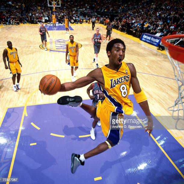 Kobe Bryant of the Los Angeles Lakers goes in for a slam dunk against the New Jersey Nets during the NBA game at the Staples Center in Los Angeles...