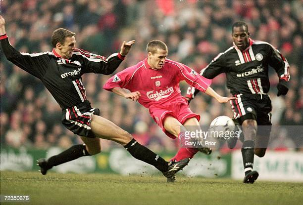 Michael Owen of Liverpool is closed down by Steve Vickers and Ugo Ehiogu of Middlesbrough during the FA Carling Premier League match played at...