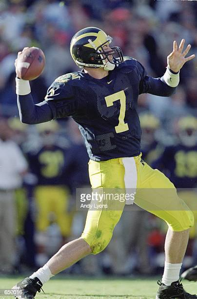 Quarterback Drew Henson of the Michigan Wolverines passes the ball during the Citrus Bowl Game against the Auburn Tigers at the Citrus Bowl in...