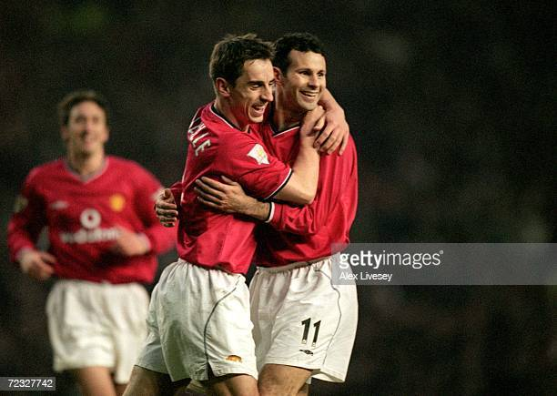 Ryan Giggs and Gary Neville of Manchester United celebrate during the FA Carling Premier League match against Aston Villa played at Old Trafford in...
