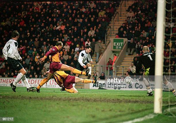 Ryan Giggs of Manchester United scores the second goal during the FA Carling Premiership match against Bradford City played at Valley Parade in...