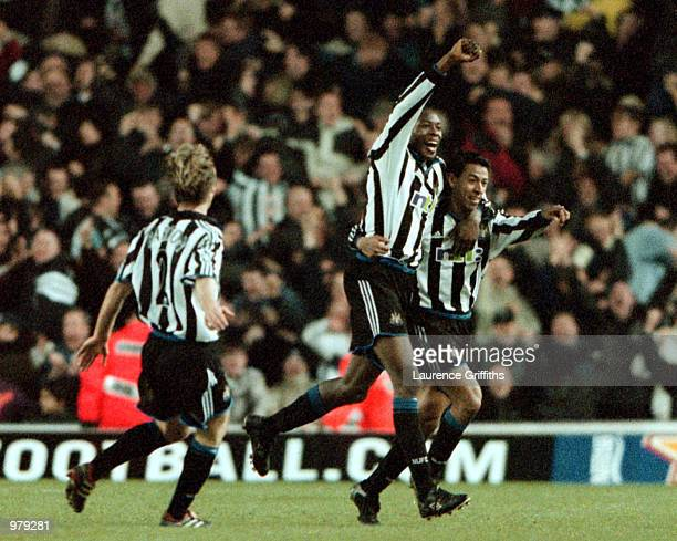 Shola Amoebi of Newcastle United is congratulated by Nolberto Solano after scoring his teams third goal during the FA Carling Premiership game...