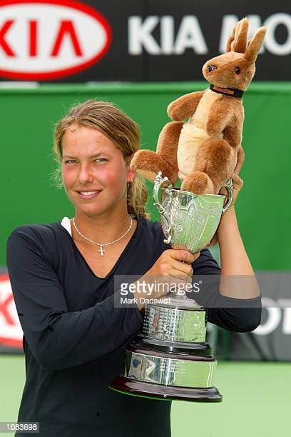 Barbora Strycova of the Czech Republic celebrates with the Girls Singles Trophy after defeating Maria Sharapova of Russia during the Australian Open...