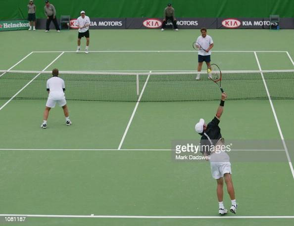 Brad Drewett and Laurie Warder of Australia wait to receive from Darren Cahill and Mark Kratzmann of Australia during the Australian Open 2002 Tennis...