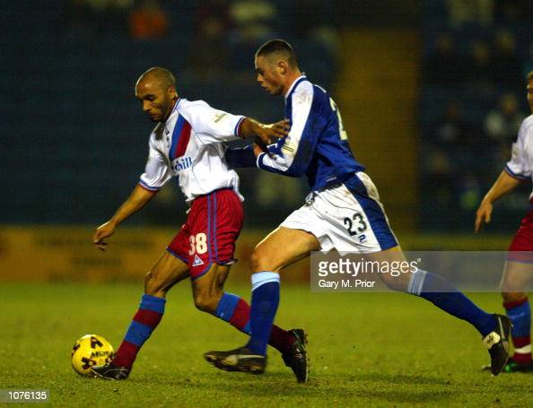 Curtis Fleming of Palace holds off Damien Delaney of Stockport during the match between Stockport County and Crystal Palace in the Nationwide...