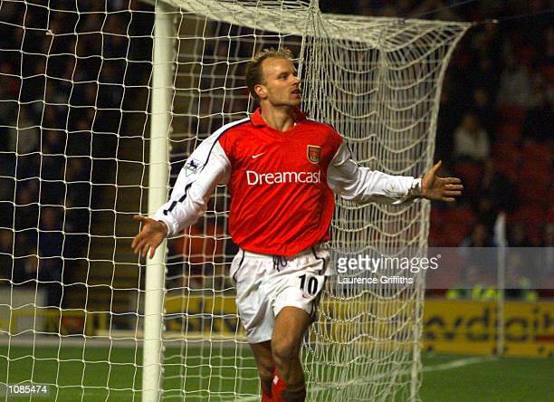 Dennis Bergkamp of Arsenal celebrates after scoring his second goal during the match between Blackburn Rovers and Arsenal in the FA Barclaycard...