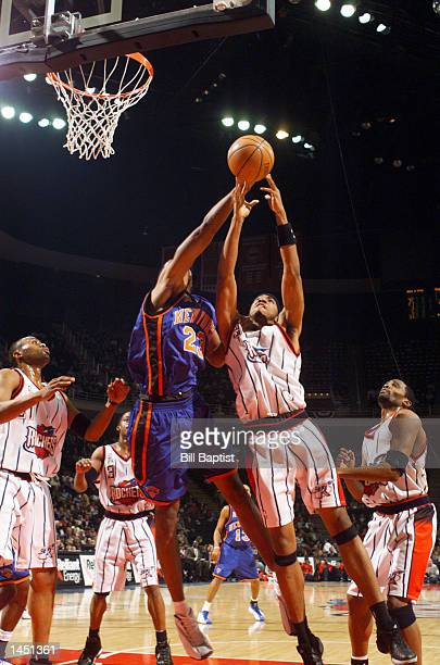 Eddie Griffin of the Houston Rockets outjumps Marcus Camby of the New York Knicks for a rebound during first quarter NBA action at the Compaq Center...