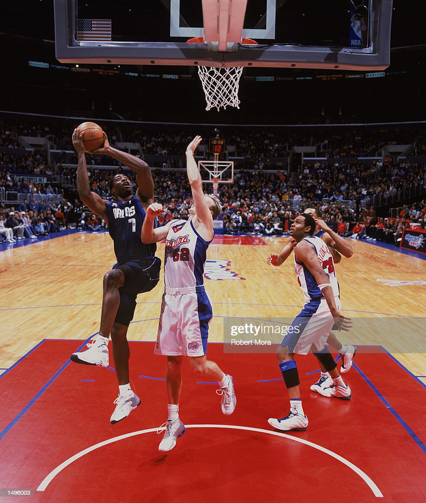 Forward Adrian Griffin of the Dallas Mavericks shoots over guard Eric Piatkowski of the Los Angeles Clippers during the NBA game at the Staples...