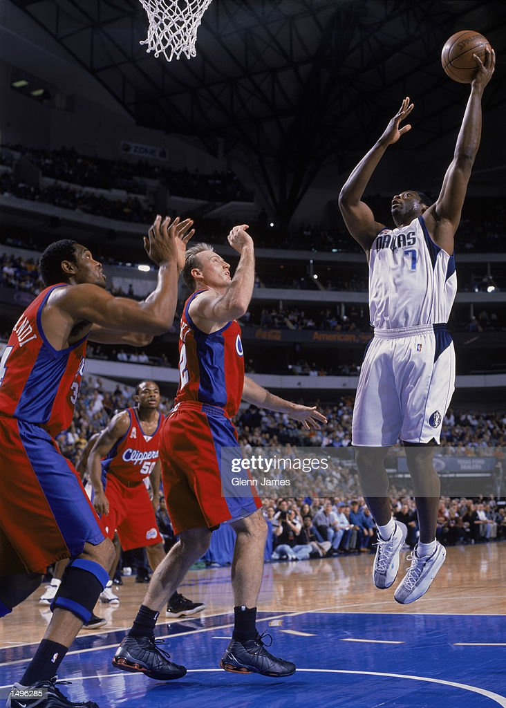 Forward Adrian Griffin of the Dallas Mavericks shoots over guard Eric Piatkowski of the Los Angeles Clippers during the NBA game at the American...