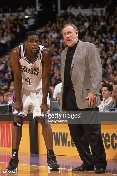 Forward Chris Webber of the Sacramento Kings listens to head coach Rick Adelman during the NBA game against the Los Angeles Clippers at Arco Arena in...