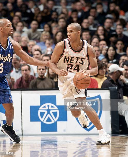 Forward Richard Jefferson of the New Jersey Nets advances with the ball towards the basket as forward Monty Williams of the Orlando Magic plays...