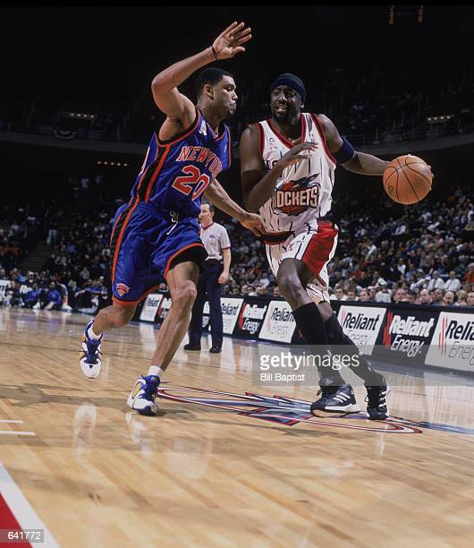 Forward Walt Williams of the Houston Rockets dribbles around guard Allan Houston of the New York Knicks during the NBA game at the Compaq Center in...