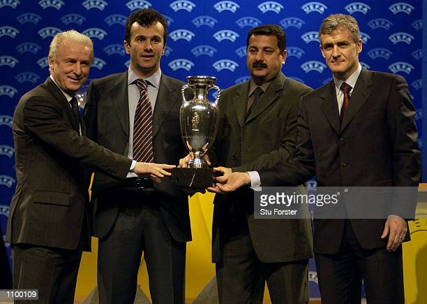 Giovanni Trappatoni of Italy Dejan Savicevic of Yugoslavia Vaguf Sadygov of Azerbaijan and Mark Hughes of Wales after the draw for the Euro 2004...