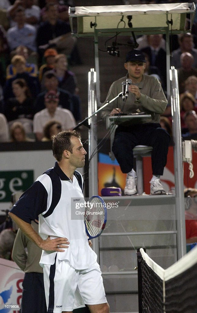 Greg Rusedski of Great Britain argues with the umpire over a bad line call as he loses to Tim Henman of Great Britain during the Australian Open 2002 Tennis Championships at Melbourne Park, Melbourne, Australia. DIGITAL IMAGE. Mandatory Credit: Clive Brunskill/Getty Images