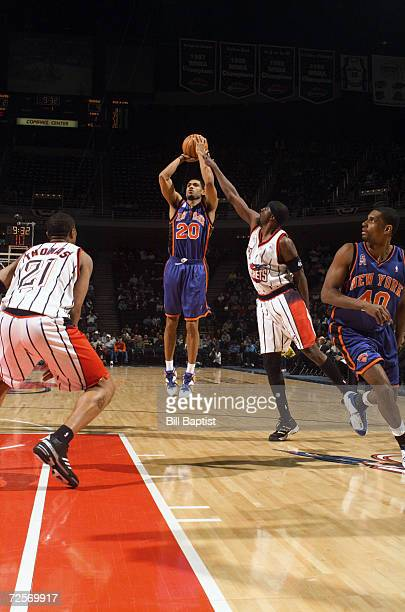 Guard Allan Houston of the New York Knicks shoots over guard Walt Williams of the Houston Rockets during the NBA game at the Compaq Center in Houston...