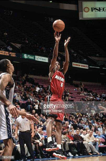 Guard Eddie Jones of the Miami Heat shoots a jump shot during the NBA game against the New Jersey Nets at Continental Airlines Arena in East...
