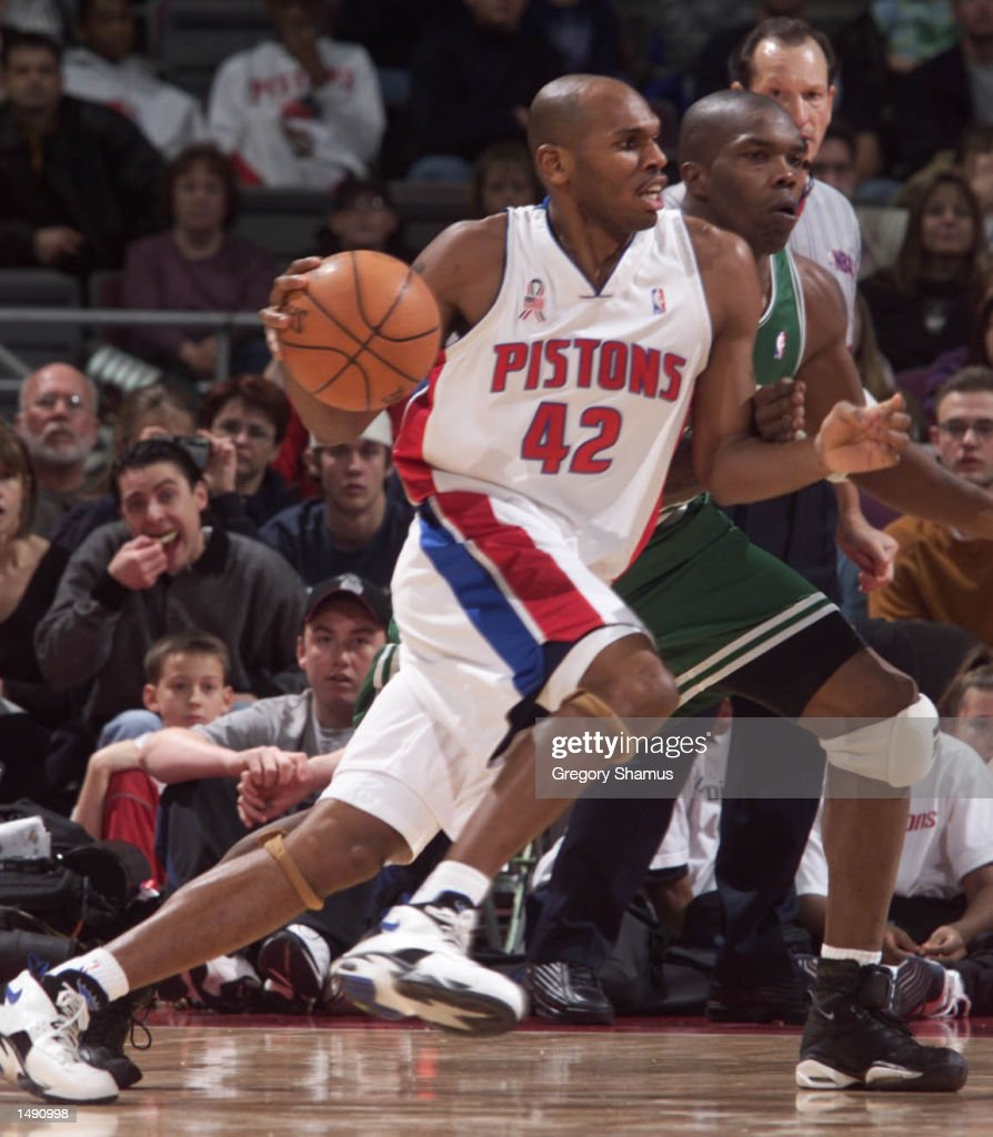 Jerry Stackhouse 42 of the Detroit Pistons drives against Eric
