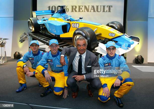 LR Jarno Trulli Jenson Button Flavio Briatore and Fernando Alonso pose during the launch of the new Renault F1 R202 Formula One car at the...