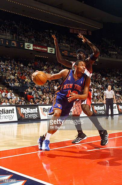 Mark Jackson of the New York Knicks dribbles past Walt Williams of the Houston Rockets on his way to the basket during first quarter NBA action at...