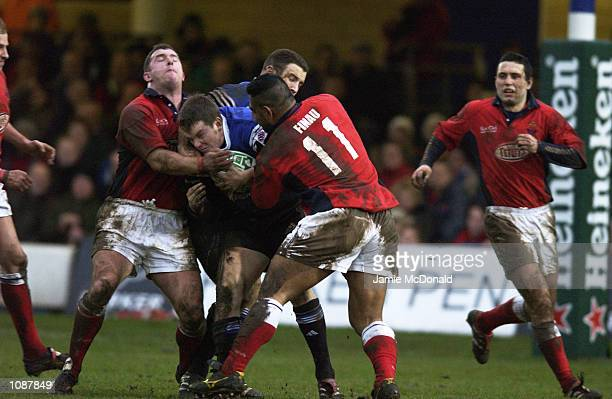 Matt Perry of Bath is tackled during the Heineken Cup quarter final game between Bath and Llanelli at the Recreation Ground in Bath DIGITAL IMAGE...