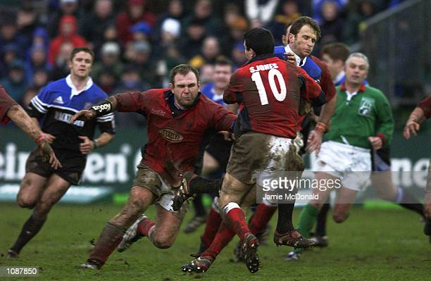 Mike Catt of Bath is tackled by Stephen Jones and Scott Quinnell of Llanelli during the Heineken Cup quarter final game between Bath and Llanelli at...