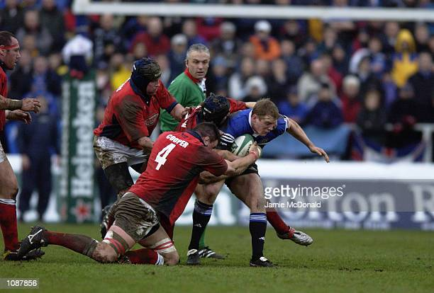 Mike Tindall of Bath is wrapped up by the Llanelli defence during the Heineken Cup quarter final game between Bath and Llanelli at the Recreation...