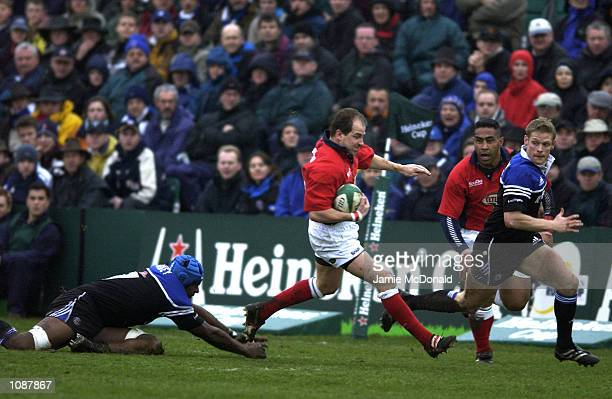 Neil Boobyer of Llanelli goes past Mark Gabey of Bath during the Heineken Cup quarter final game between Bath and Llanelli at the Recreation Ground...