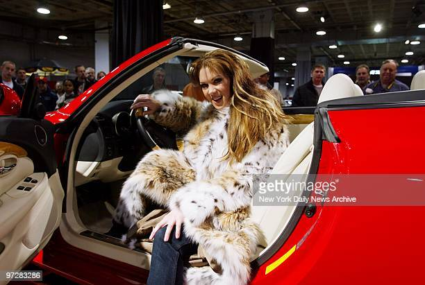 Jan 2002 Playboy cover model Joanie Laurer formerly the WWF star Chyna sits in style in a $62000 Lexus 430 at the Washington DC auto show which runs...